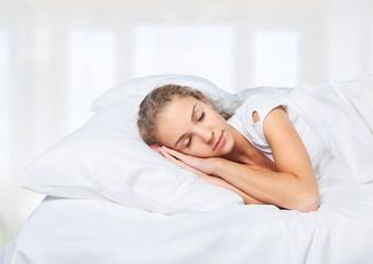 Adult. Beautiful girl sleeps in the bedroom