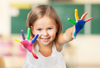 Arms. Boy with hands painted in colorful paints ready to make