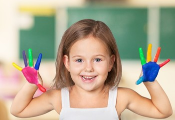 Kid. Funny young girl with brightly painted hands. Isolated on