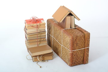 a vintage suitcase with a bunch of books