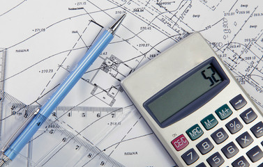 Drawing accessories and calculator on construction drawing