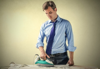 Businessman doing the ironing