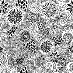 Seamless  floral doodle black and white background pattern in