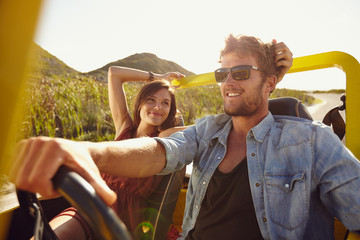 Loving young couple on road trip