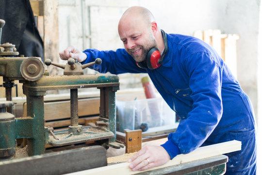 Man working on a machine at workshop