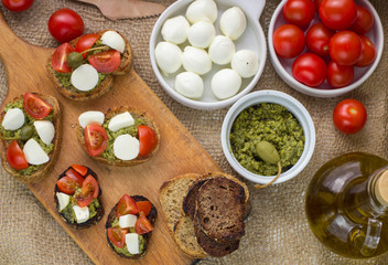 Bruschetta with fresh tomatoes, mozzarella and  herb pesto