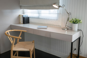 white table with wooden chair and books in modern working area a