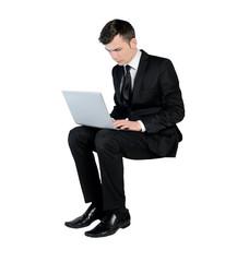 Business man typing laptop