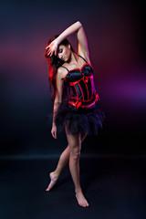 Burlesque brunette dancer in short dress