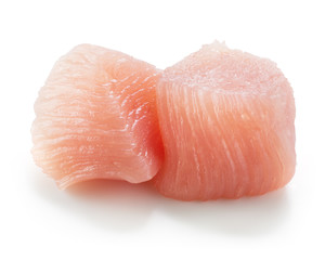 Raw chicken fillet. Small pieces of meat isolated on white.