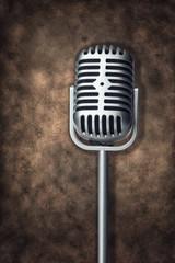 Retro microphone on brown grunge texture