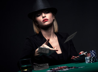 Beautiful young woman playing poker