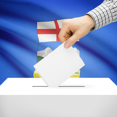 Ballot box with Canadian province flag on background - Alberta