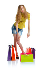 Emotional lovely woman with shopping bags over white
