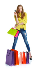 Shopaholic woman with shopping bags and credit card over white b
