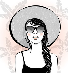 Beautiful girl with sunglasses and hat