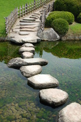 Bridge made of stones in a Japanese garden
