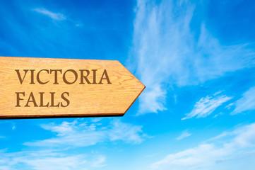 Wooden arrow sign pointing destination VICTORIA FALLS