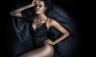 Beautiful tawny woman lying on the couch