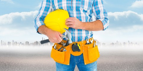 Image of manual worker wearing tool belt