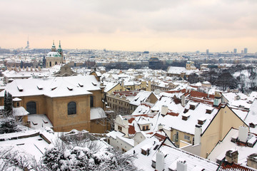 Snowy Prague  with St. Nicholas' Cathedral, Czech Republic
