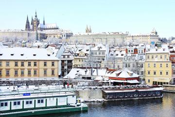 Snowy Prague gothic Castle above River Vltava