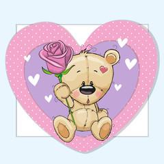 Teddy bear and a flower