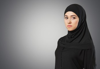 Adult. Muslim young woman wearing hijab on white