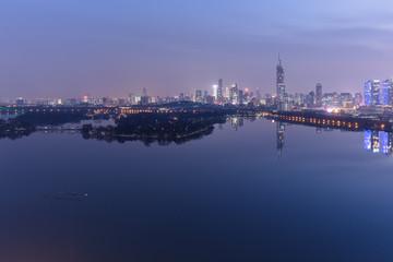 Fototapete - modern nanjing city skyline with the beautiful lake at night