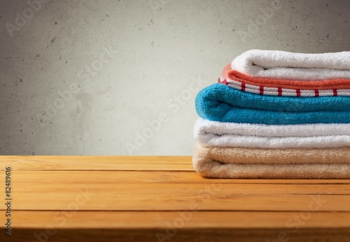 Bathroom Retro Background With Fresh Towels On Wooden Table