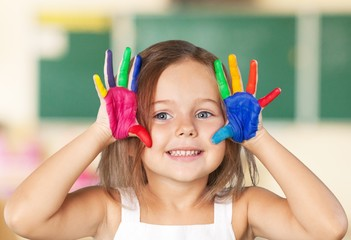 Girl. Cute smiling little girl with hands in paint isolated