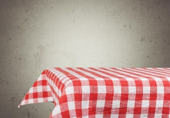 Advertise. Background with table and tablecloth over grunge
