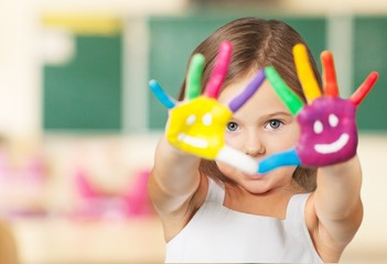 Arm. Painted children's hands in different colors with smilies