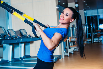 TRX. fitness, sports, exercise, technology and people concepts -