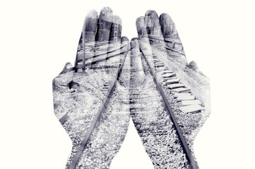 double exposure of man hands and railway, in black and white