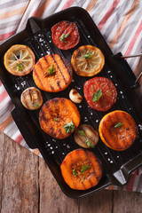 Grilled pumpkin closeup on grill pan. Top view vertical