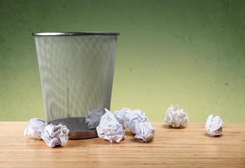 Concept. Office garbage near metal basket
