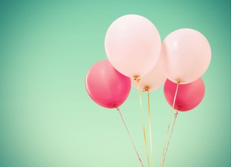 Abstract. Four Vintage Pink Balloons Over Turquoise Sky