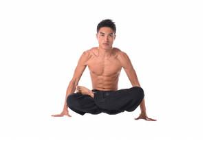 Muscular male model in sportwear sitting on the floor,