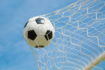 .Soccer ball in the goal after shooted