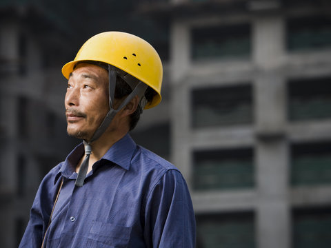 Thoughtful construction worker at construction site