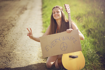 Beautiful hippie woman on a country road