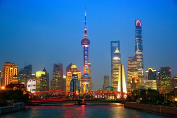 Shanghai skyline at dusk with illuminated Waibaidu bridge, China