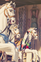 Carousel horses. Vintage tone.