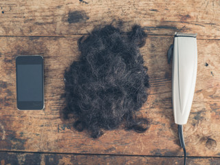 Phone, hair and clippers