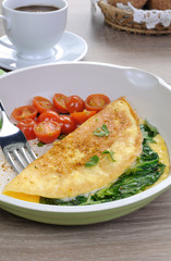 Omelet with tomatoes and herbs