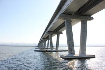 Large bridge over water seen from below