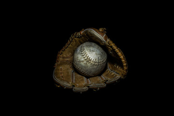 Softball in Glove on Black