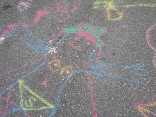 Colored chalks. Colored chalk on playground with drawings on str