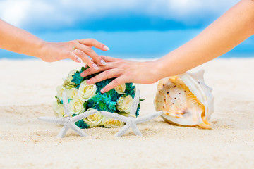 Male and female hands, two wedding rings with two starfish, wedd